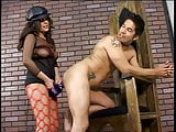 Gorgeous fem domm in lingerie and bondage gear fucks guy with strapon