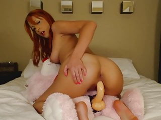 Redhead Teen Rides Dildo On Teddy Bear