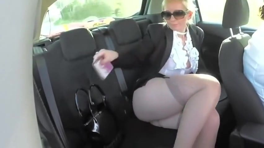 Blonde Mature With Sexy Legs Shows Stocking Tops