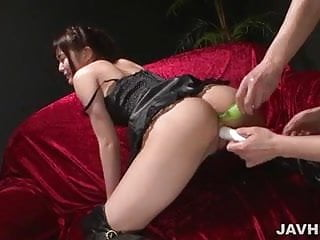 Latex clad Megumi Shino finds herself in a nasty threesome.