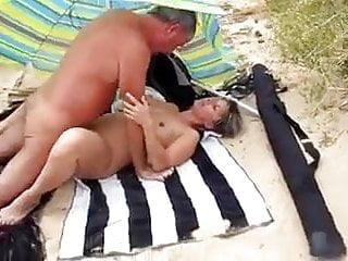 Amateur Couple on Beach with Stranger