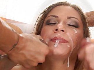 Brunette takes a simultaneous double facial...
