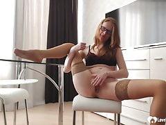 Redhead Masturbating In Tan Stockings