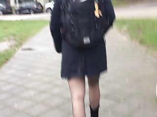 Young blond student in mini skirt with transparent nylons