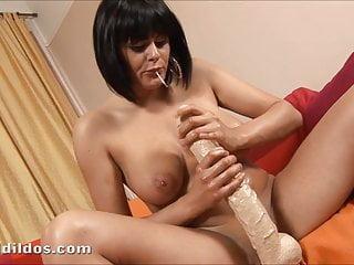 Romana has fun riding a big white brutal dildo