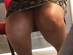 Legs under the table of a venezolan english teacher
