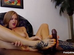Tattooed Hottie Gives A Footjob To Lucky BBC
