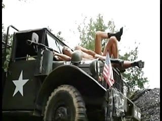Military twink on the hood of a truck...