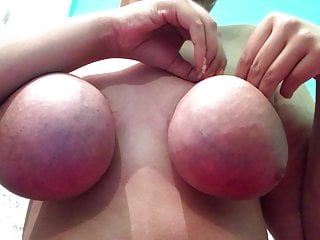 Untying my pink, baggy boobs